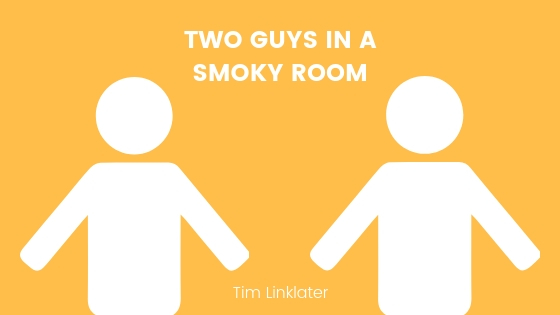 Two guys in a smoky room